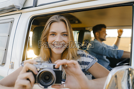 portrait of happy woman with camera