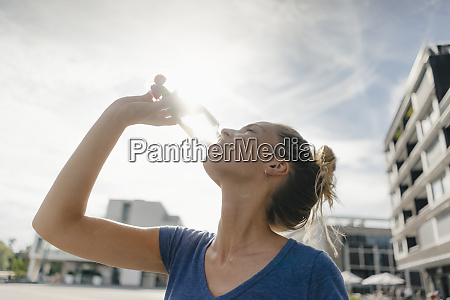 netherlands maastricht young woman drinking from
