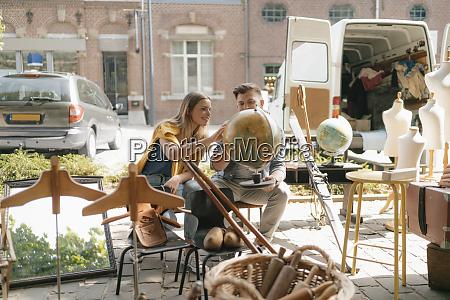 belgium tongeren young couple examining globe