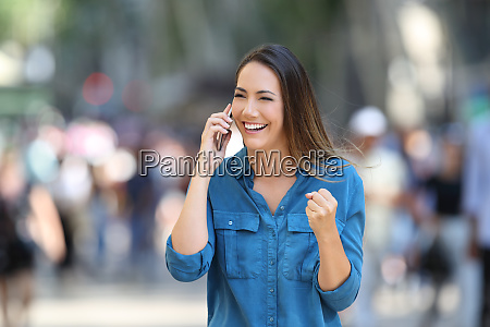 excited woman receiving good news on