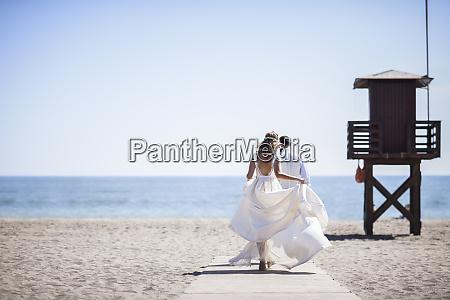 back view of bridal couple enjoying