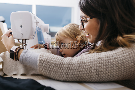 happy mother with little daughter at
