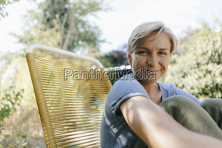 portrait of smiling woman sitting in