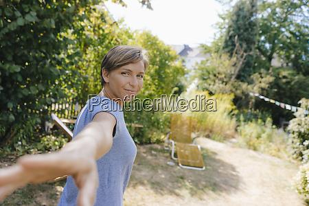 portrait of smiling woman in garden