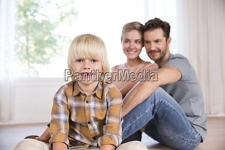 portrait of smiling boy with parents
