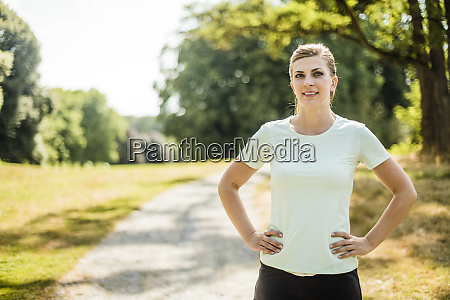 portrait of smiling sportive young woman