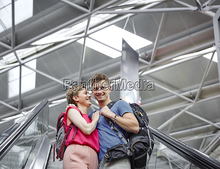 happy couple on escalator at the