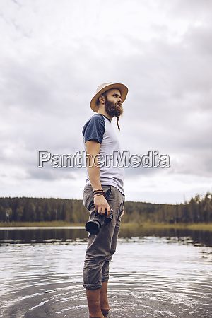 sweden lapland man with camera standing