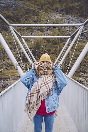 young woman standing on a windy