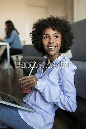 happy woman with soft drink sitting