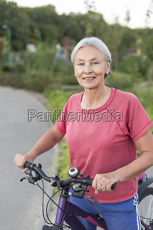 portrait of senior woman with bicycle