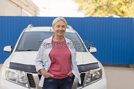 portrait of smiling senior woman standing