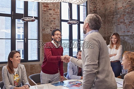 colleagues greeting at a presentation in