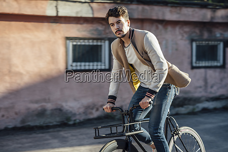 young man riding commuter fixie bike