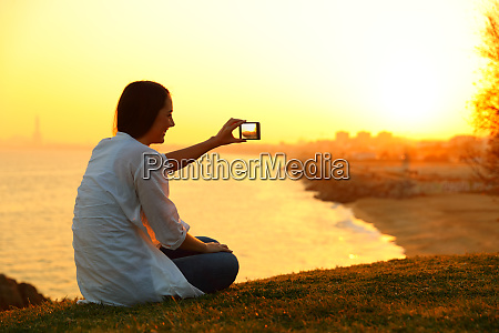 woman taking photos with a smart