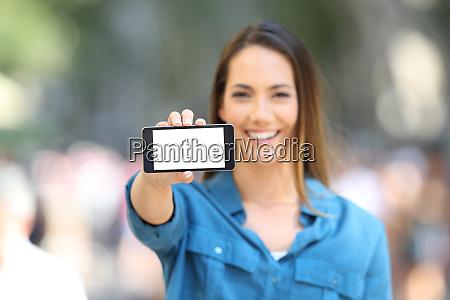 woman showing a blank horizontal phone