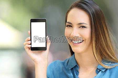happy lady showing a blank phone