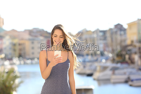 happy woman on vacation using smart
