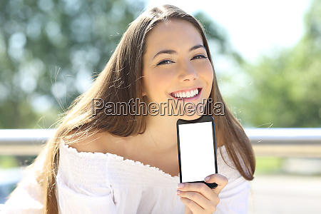happy woman showing blank phone screen
