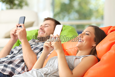 couple using their smart phones