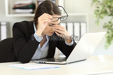 office worker suffering eyestrain at work