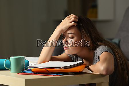 tired student trying to study in