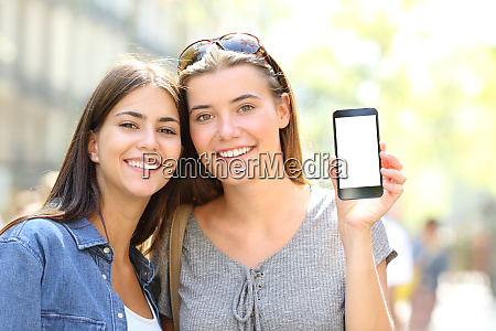 two happy friends showing a smart