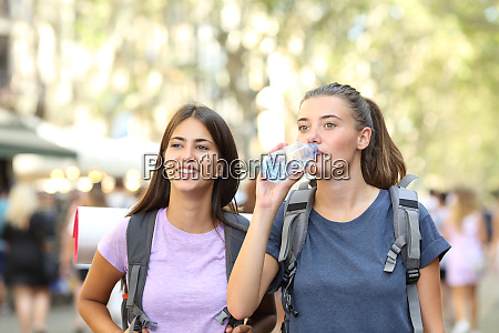 backpackers sightseeing walking on vacation in