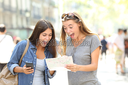 excited tourists traveling finding location in