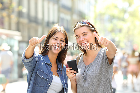 friends holding phone looking at you