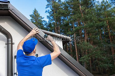 roofer installing metal drip edge profile