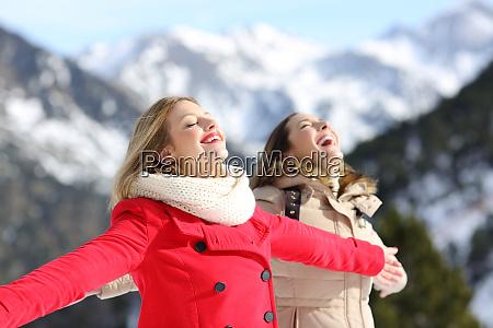 two friends breathing fresh air in