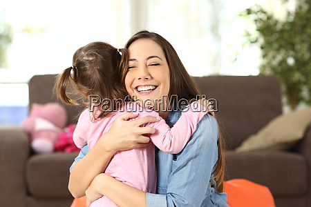 mother embracing to her baby daughter
