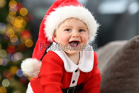 kid wearing santa costume looking at