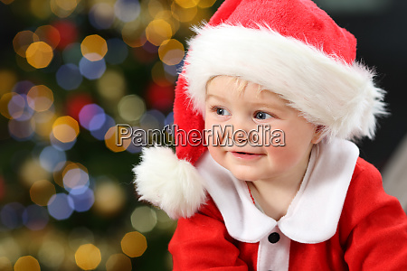 portrait of a baby wearing santa