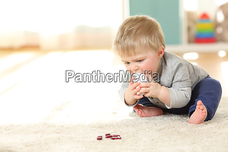 baby in danger playing with a