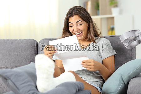 excited disabled girl reading a paper