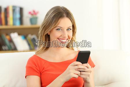 girl looking at camera holding a