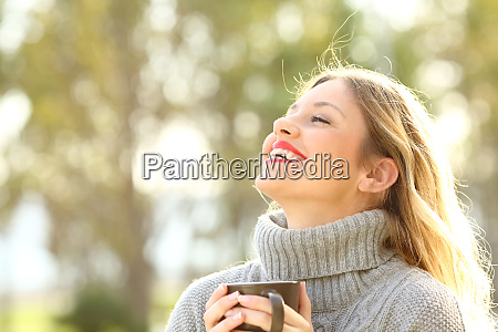 happy lady breathing fresh air in