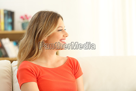 profile of a happy woman looking