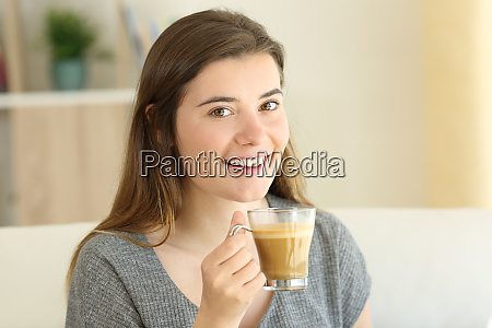 happy teen holding a coffee with