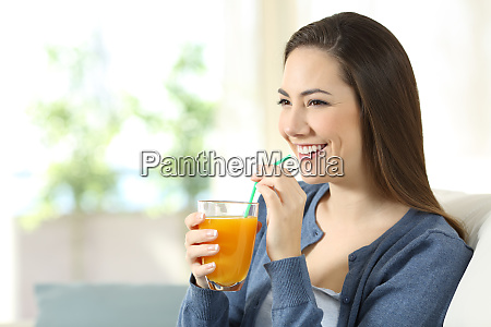 happy girl holding an orange juice