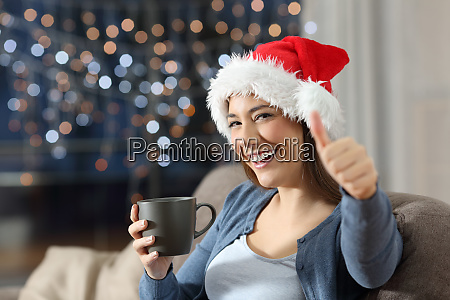 happy woman with thumbs up on