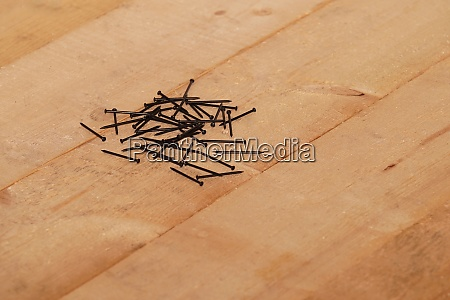 steel nails on a wooden floor