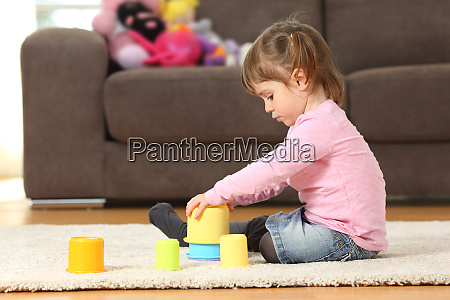 kid playing with toys at home