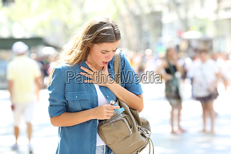 asthmatic girl suffering an attack and