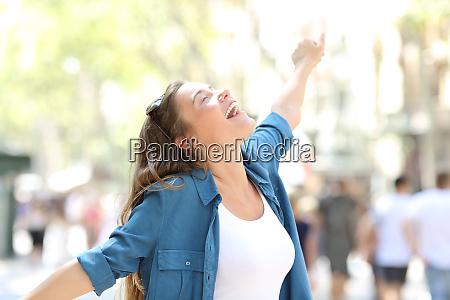 happy spontaneus woman stretching arms