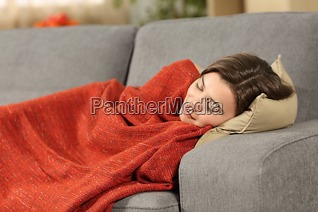 girl sleeping on a couch at
