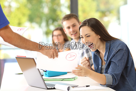 excited student receiving an approved exam