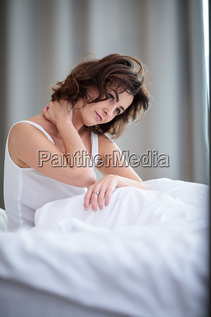 pretty young woman with stiff neck